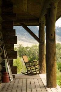 Idaho-log-home-covered-porch-rocker